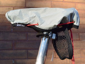 North Street Saddle Cover with mesh pouch. The pouch attaches to the saddle rails with Velcro.