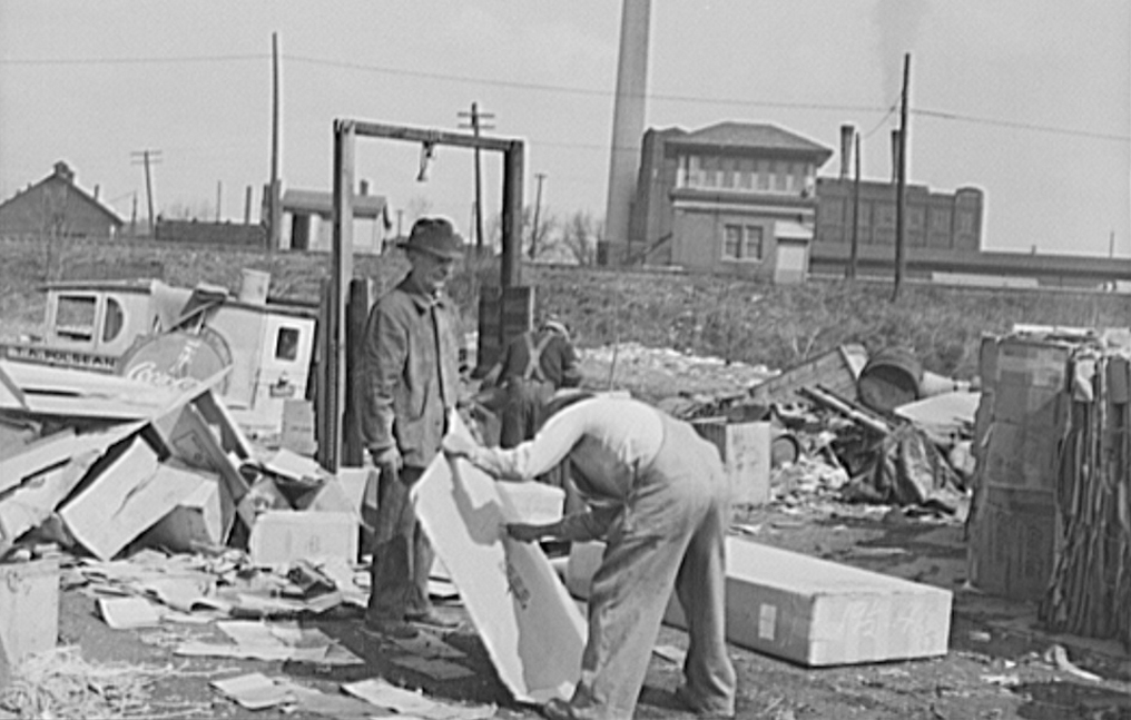 black and white photo of men working with cardboard boxes