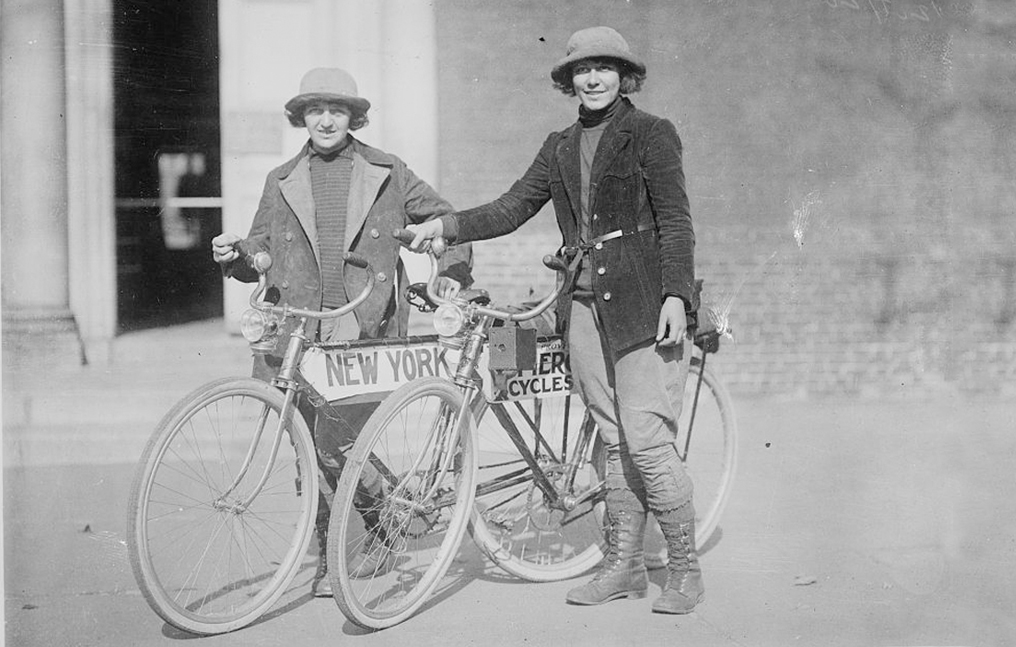 Perennial Cycle mechanics are experienced builders of previously built bikes, like the touring bikes in this black and white image of two women cycle tourists.
