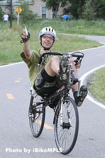 Calhoun Cycle owner Luke Breen rides his recumbent in the 2012 Powderhorn 24