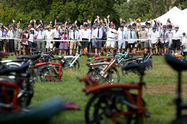 Riders wave before the start of the Brompton World Championship
